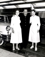 Jackie Gleason posing with Nurses