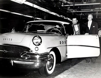 Jackie Gleason posing in his new Buick