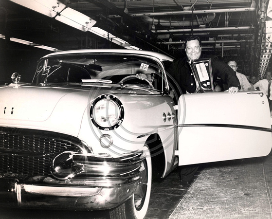 Jackie Gleason Comedian hops into his new Buick