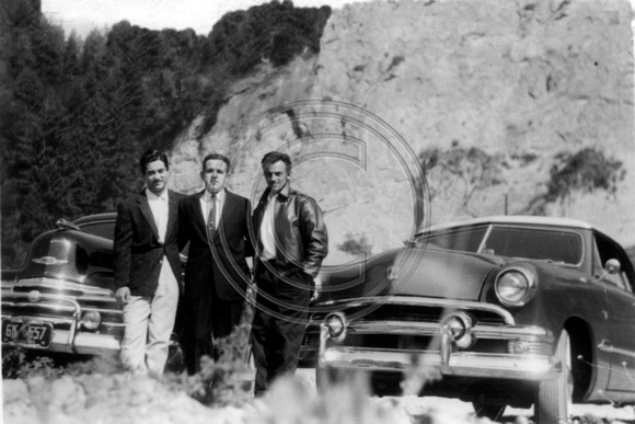 Joe Rocha on the right  posing with his 2 buddies and their cars with the Rio Dell Bluffs behind them.