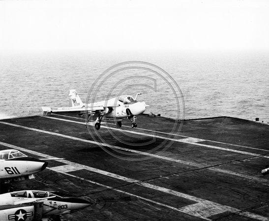 Navy jet landing on the Carrier Kitty Hawk