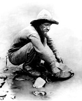 Old timer panning for gold