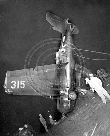 F-6-F Hellcat Being righted after crashlanding