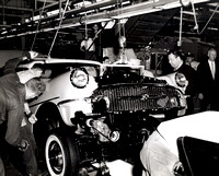 Jackie Gleason Comedian observes a Buick being assembled